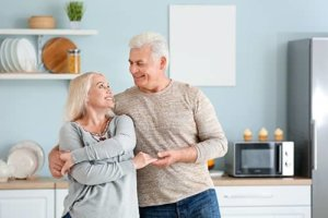 a couple is pleased with exclusive senior living programs